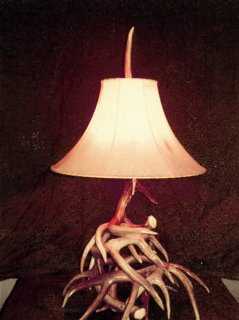 Professionally made antler lamps and furniture .  Choose from Whitetail, Elk, Mule deer, or Moose horns.